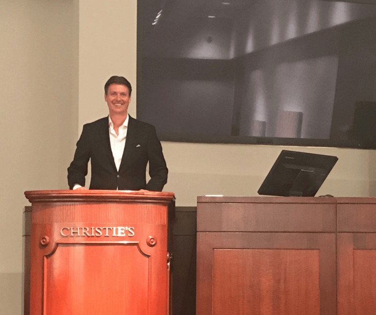 Michael Baynes (Maxwell-Baynes) on the podium at Christie's International Real Estate, New York